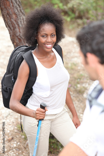 Mixed-race couple hiking