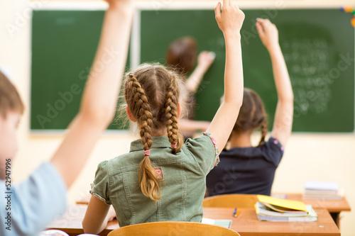 Leinwanddruck Bild School children in classroom at lesson