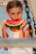 Summer joy, lovely girl eating fresh watermelon on the beach