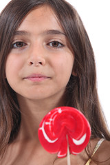 Girl licking a lollipop