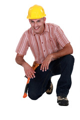 Portrait of a craftsman to his knees on the floor