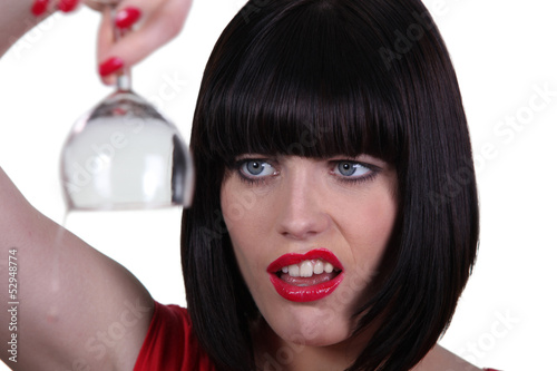 Woman holding empty wine glass