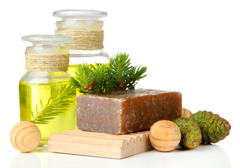 Hand-made soap and bottles of fir tree oil, isolated on white