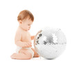 child playing with disco ball