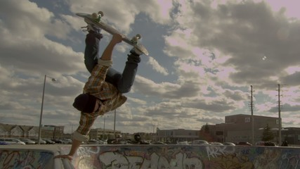 Skateboarder Extreme Handplant Trick