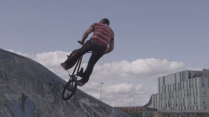 Extreme Sport BMX Biker Does Tailwhip Jump