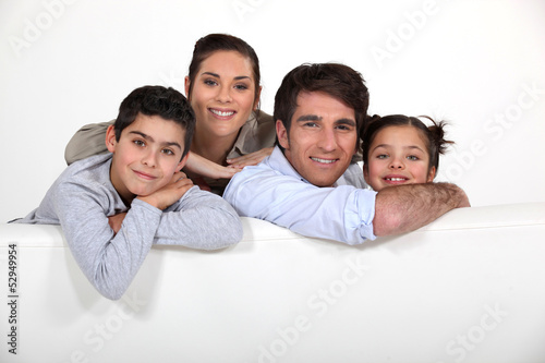 Young family with a board left blank for your image