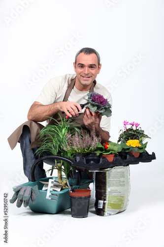Gardener knelt by plants