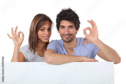Couple giving the OK gesture