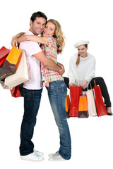 Three people with shopping bags