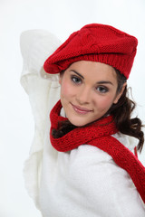 Woman in a winter hat and scarf