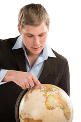 Business man holding globe
