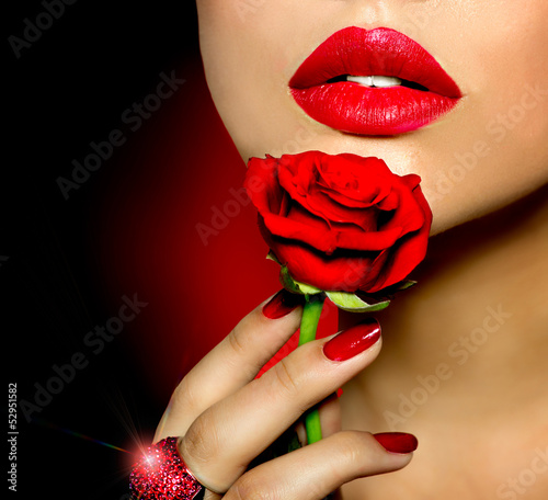 Beautiful Red Lips, Nails and Rose Flower. Beauty Girl