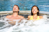 Spa couple relaxing enjoying jacuzzi hot tub