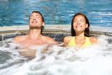 Fototapety Spa couple relaxing enjoying jacuzzi hot tub