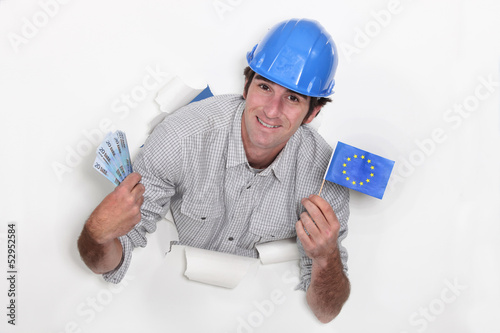 A male construction worker with cash and a European flag.