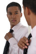 Young businessman adjusting tie before interview