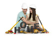 Home under construction: Overjoyed couple with machines building