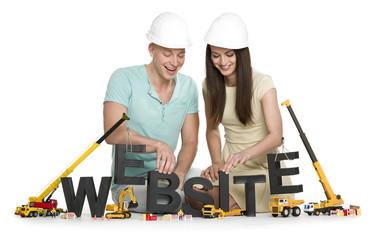 Website under construction: Joyful man and woman building websit
