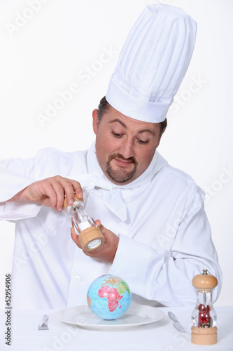 Chef putting salt on his meal