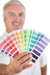 Man holding paint swatch