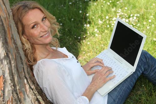 Woman on laptop outside