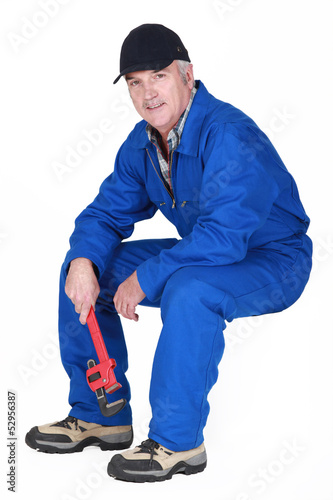 Middle-aged plumber sat down