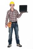 A handyman with a laptop.