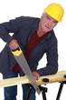 Artisan sawing wood