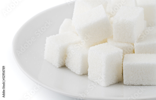 Sugar cubes in saucer