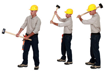 Men holding sledge-hammers