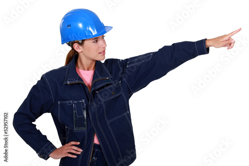 A female manual worker pointing at something.