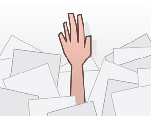 Single hand reaching from pile of papers