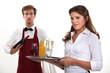 Wine waiter and waitress, studio shot