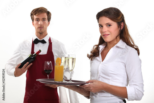Wine waiter and waitress, studio shot