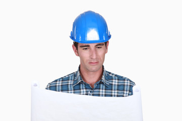 A foreman checking plans.