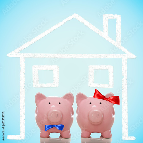 Piggy bank couple with dream home
