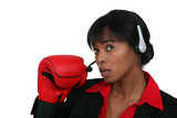 Call center worker with boxing gloves
