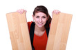 craftswoman holding two laminated boards