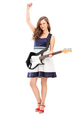Full length portrait of an excited female playing on electric gu