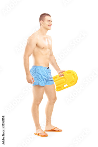 Full length portrait of a male lifeguard on duty posing