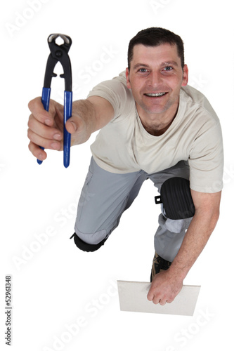 Man holding pair of clippers