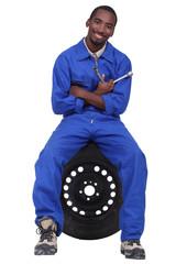 Mechanic sitting on a wheel