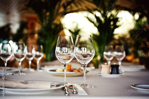 Empty glasses set in restaurant - 52961582