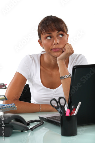 cute female student with computer looking pensive