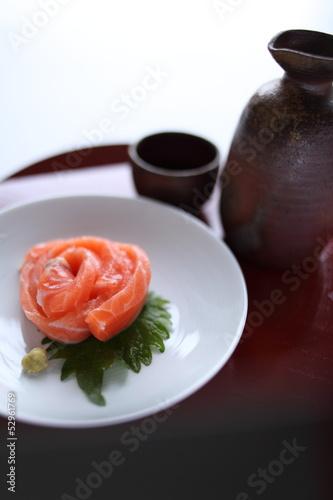 Japanese food, salmon sashimi and sake