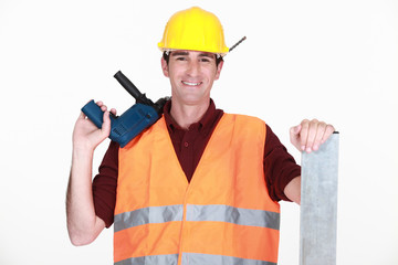 Worker with a large drill