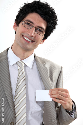 Businessman with glasses showing off business-card