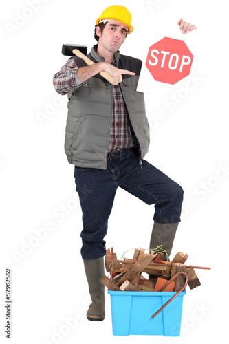 Builder with a Stop sign