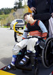 Disabled boy on school bus wheelchair lift